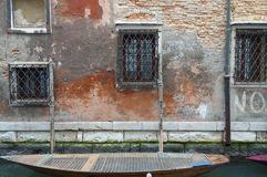 Boat docked to a house wall in a canal at Venice, Italy Royalty Free Stock Photos