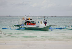 A boat docking on beach in Boracay, Philippines.  royalty free stock photo