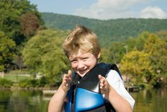 Boat docking directions. Young boy giving directions to dock a boat at the camping area on a lake Stock Images