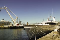 Boat docking at Victoria Wharf, Cape Town stock image
