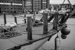 Boat on the docks. Boat docks ack black white old stock images