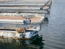 Boat docks lined up. Old boat docks at the lake Royalty Free Stock Image