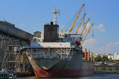 Boat in dockyard - landscape. Boat hauled up in the dockyard for unloading Royalty Free Stock Images