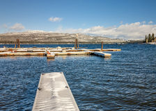 Boat Docs covered with snow at an Idaho lake Royalty Free Stock Photography
