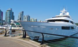 Boat at Downtown Vancouver Waterfront in Canada Stock Photography