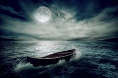 Boat drifting away in middle ocean after storm Royalty Free Stock Photos