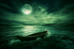 Boat drifting away in middle ocean after storm royalty free stock image