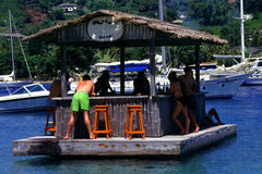 Boat Drinks. Vacationers enjoy good times,good friends, and good booze in a tropical setting Royalty Free Stock Photo