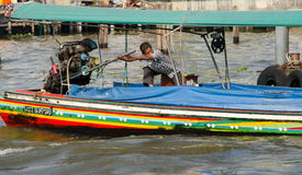 Boat driver in thailand. Boat driver in river at  thailand Stock Photography