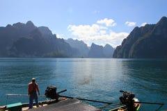 Boat driver  for transfer passenger in dam ,Khaosok National Par Stock Photo