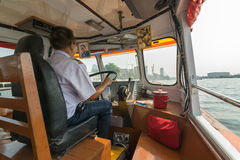 Boat driver for travel on the Chao Phraya river Royalty Free Stock Image