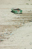 Boat in drought. Abandoned boat on the floor of a lake after drought Royalty Free Stock Photos