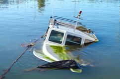 The boat drowned in the Mediterranean. Filled with water. Athens, Greece.  royalty free stock photo