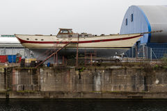 Boat in dry dock on Cardiff Bay, Wales, UK Royalty Free Stock Image