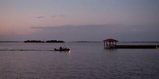 Boat at dusk Stock Photo
