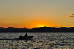 Boat at dusk Stock Photos