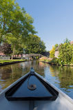 Boat in Dutch village Giethoorn Royalty Free Stock Images
