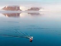 Boat dwarfed Stock Image