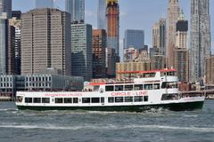 Boat in East River, New York City Stock Photo
