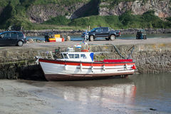 Boat at ebb tide Stock Photo