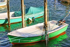 Boat at embankment in Ascona resort in Ticino Switzerland Royalty Free Stock Photo