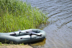 Boat. Empty inflatable rubber boat on the river Stock Images