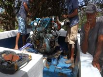A boat engine being repaired in the caribbean stock video