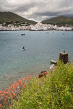 Boat entering Cadaqués. Costa Brava, Spain. Stock Photography