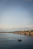 Boat at the entrance of Antalya. On a quiet sea, Turkey Royalty Free Stock Photo