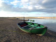 Boat by an estuary Stock Photography