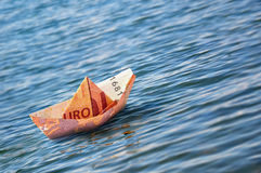 Boat Euro Money Origami. Ten euro origami boat on the sea Stock Images