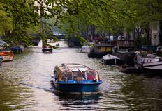 Boat excursion through the canals in Amsterdam. Tourist activities in Amsterdam. Boat excursion through the canals Stock Photos
