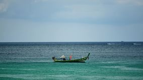 Boat excursions floating in the sea of tropical beaches On a sunny day. PHUKET , THAILAND,DEC 2017 : Tourist boat or Boat excursions Floating in the sea of stock footage