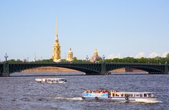Boat excursions on the Neva river in St.Petersburg. Russia. View of Peter and Paul Fortress and Trinity Bridge Royalty Free Stock Images
