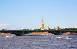 Boat excursions on the Neva river in St.Petersburg. Russia. View of Peter and Paul Fortress and Trinity Bridge royalty free stock photos