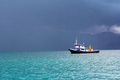 Boat is facing the storm. The gulf of Thailand - June 7 : Unidentified fishing boat is facing with the strom on 7 June 2013 in The gulf of Thailand stock photography
