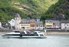 Boat fast and small town on the banks of the Rhine in Germany Stock Images
