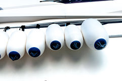 Boat Fender Bumper Guard hang on the rail. Of yacht Royalty Free Stock Photo