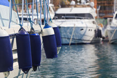 Boat fenders. Luxury yacht fenders hanging on a motor boat Royalty Free Stock Image