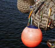 Boat fenders and fishing lures. Three boat fenders with fishing lures attached to one of them Royalty Free Stock Images