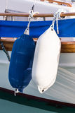 Boat fenders. Luxury yacht fenders hanging on a motor boat Royalty Free Stock Photography