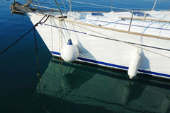 Boat Fenders on White Yacht. Detail and water reflections of white boat fenders on white yacht Stock Images