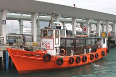 Boat at ferry pier, city transport from central island, Hongkong Stock Photo