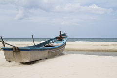 Boat fiber on the beach. Royalty Free Stock Images