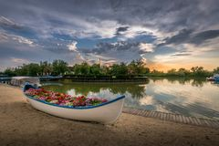 Boat filled with flowers in an iconic beautiful sunset landscape over the Danube Delta in Gura Portitei, Romania. Fishing boar filled with flowers as decoration royalty free stock photos