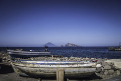 Boat of fisherman in the Aeolian Islands. In the background you can see the volcano Stromboli Stock Photography