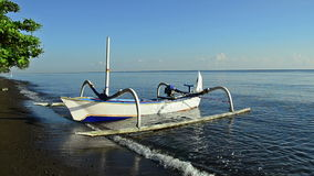 Boat of a fisherman in Bali called Jukung stock video footage