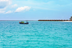 The boat of fishermen comes up in ocean. royalty free stock photography