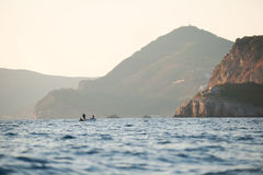 Boat with fishers in adriatic sea, Montenegro Stock Image