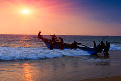 Boat and fishers Stock Photos